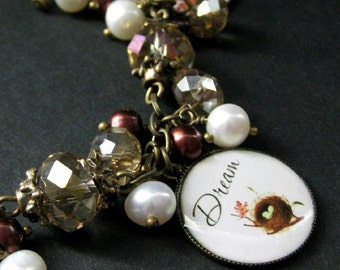 Bird Nest Charm Bracelet in Fresh Water Pearl, Taupe Crystals and Bronze. Handmade Bracelet.