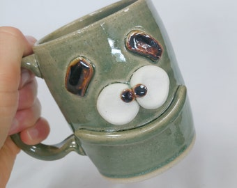 Coffee Cup Green 12 Ounces Funny Face Mugs. Stoneware Clay Ceramic Pottery. Nelson Studio Ug Chug Face Mug. Unique Uncommon Coffee Cups.