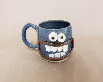 NEW. Nelson Studio Ug Chug Face Mug CHAD. Blue Smiley Face Mug Coffee Cup. 16 Ounces Large. Funny Beer Tea Soup Mugs. Handmade Stoneware.