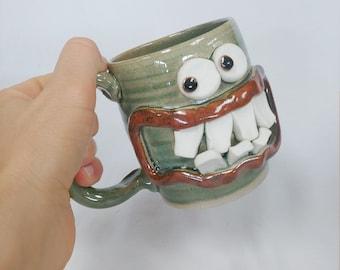 Green UgChug Face Mug. 12 Ounce Coffee Cup. Funny Keto Diet Dieter's Mug. Microwave Dishwasher Safe Pottery. LUKE Nelson Ug Chug Coffee Cup