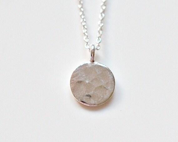Sterling silver hammered disk necklace