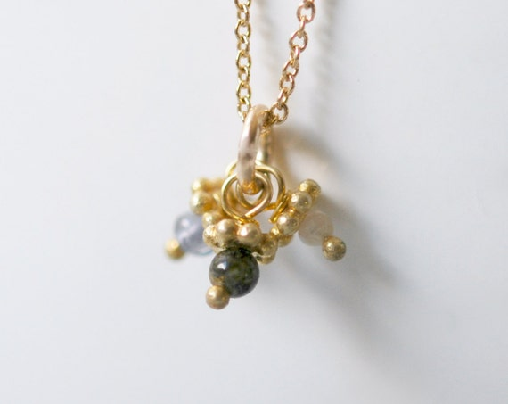 Gold gemstone cluster necklace
