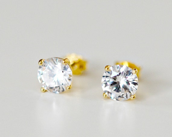Gold cubic zirconia stud earrings in round or square