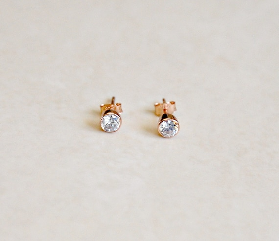 Cubic zirconia stud earrings in gold or rose gold