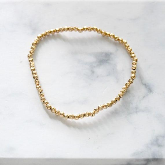 Gold hammered balls bracelet