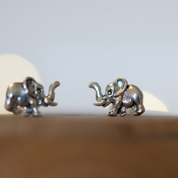 Tiny sterling silver elephant stud earrings