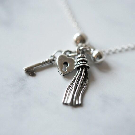 Sterling silver tassel charm necklace, lock pendant, silver key pendant, silver balls, tassel necklace, heart necklace, layering necklace