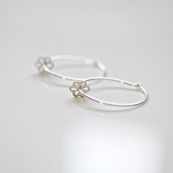 Sterling silver hoops with tiny flower