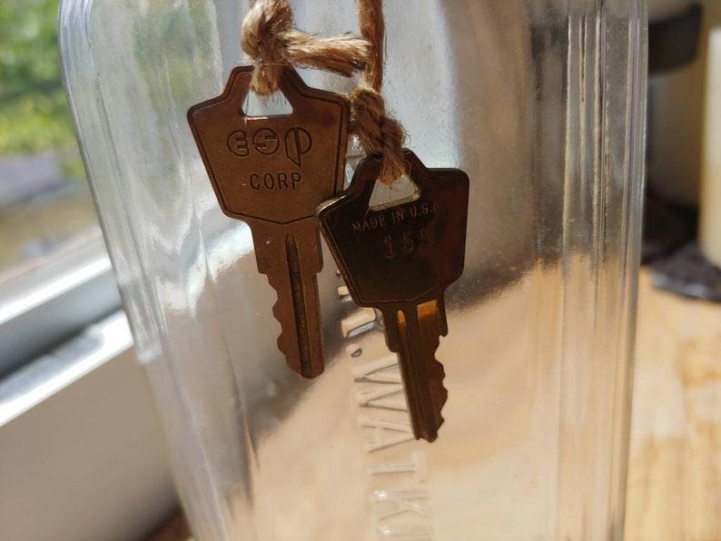 Jr Watkins vintage rectangular glass bottle with old keys