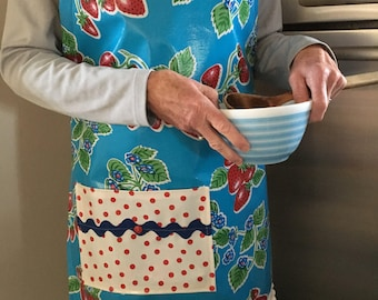 Retro oilcloth apron with red strawberries on sky blue
