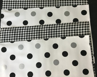 Set of four NY NY black, white and silver reversible oilcloth placemats