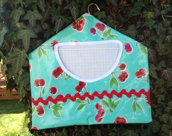 retro large oilcloth clothespin bag with cherries on seafoam green