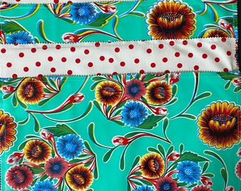 Reversible Mexican floral and red dot print oilcloth placemats