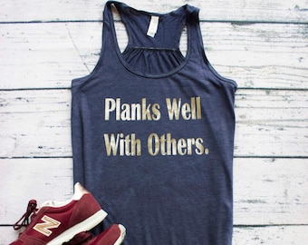 ea6f6931 Planks well with others. Funny Fitness Workout shirt. Great for Gym  Inspirational. Racerback flowy fit. Perfect gift for gym friends