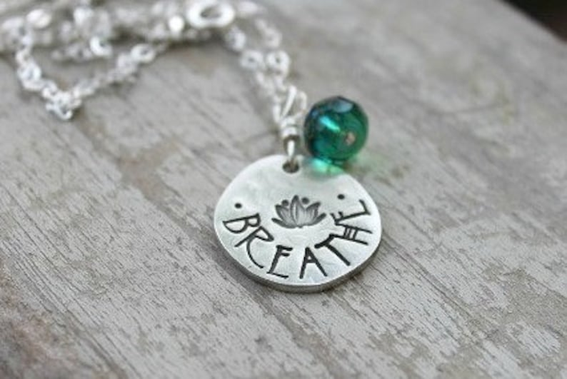 yoga breathe lotus hand stamped pewter necklace pendant image 0