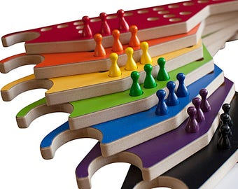 PEGS and Jokers 8-player Game with Interlocking paddles.