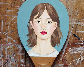 Hand painted vintage table tennis bat - a girl on a teal background