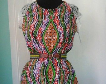 Ankara sheath in Vlisco wax block cotton and lace sleeves