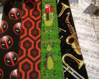Dr Seuss' The Grinch Green Christmas Neckties in bow tie, skinny tie, and standard tie styles, kids or adult sizes