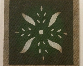 "4"" x 4"" Painted Canvas Coaster - Pinwheel - Maritime White and Herb Garden Green - by Black Horse Floorcloths"