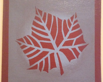 "Painted Canvas Trivet - 8"" x 8"" - Fall leaf - tea red (rust) and blue/grey by Black Horse Floorcloths"
