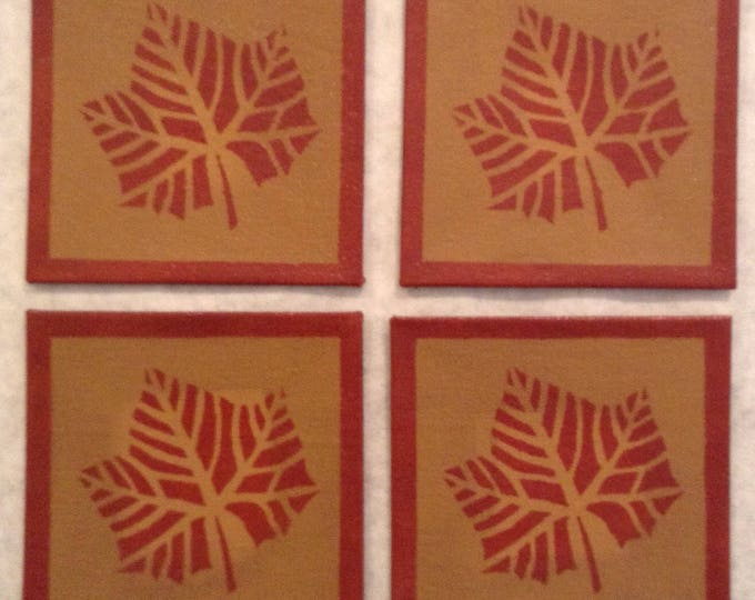"""Set of 4 - 4"""" x 4"""" Painted Canvas Coasters - Fall leaf - tea red (rust) and tan - by Black Horse Floorcloths"""