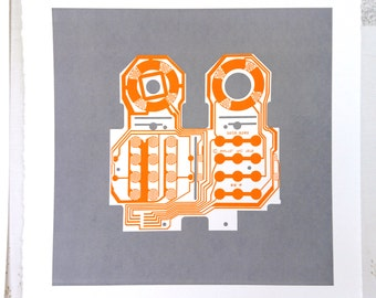Mattel Intellivision controller screen print orange and grey art silkscreen circuit portrait retro console