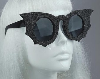 4f768487819d Black Bat Wings Glitter Sunglasses