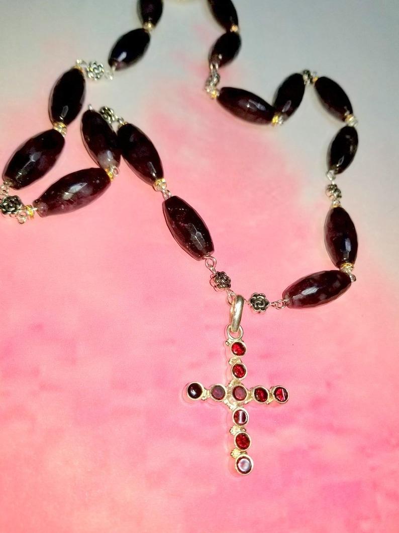 A Garnet Cross In 925 Silver and a Garnet Necklace