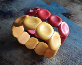 Vintage Tagua nut bracelet in orange red yellow vegetable ivory alternative rainforest jewelry