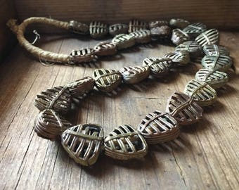 Strand of 30 vintage African lost wax cast brass beads heart cage shape brass jewelry findings