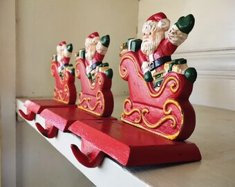 Three Small Cast Iron Santa Claus Christmas Stocking Holders for Mantle, Vintage Christmas Decor
