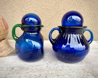Pair of Vintage Cobalt Blue Hand Blown Glass Bottles with Stoppers (One with Green Glass Handle)
