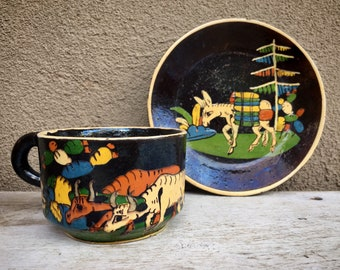 Rare 1940s Black Tlaquepaque Pottery Cup and Saucer with Colorful Village Scenes Donkey Oxen