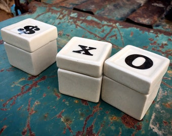 "Three Small 1-1/2"" Ceramic Lidded Trinket Boxes with Symbols X O Dollar Sign, Hugs and Kisses"