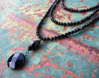 Swooping Three Strand Necklace of Cut Black Glass Crystal Beads and Faceted Pendant