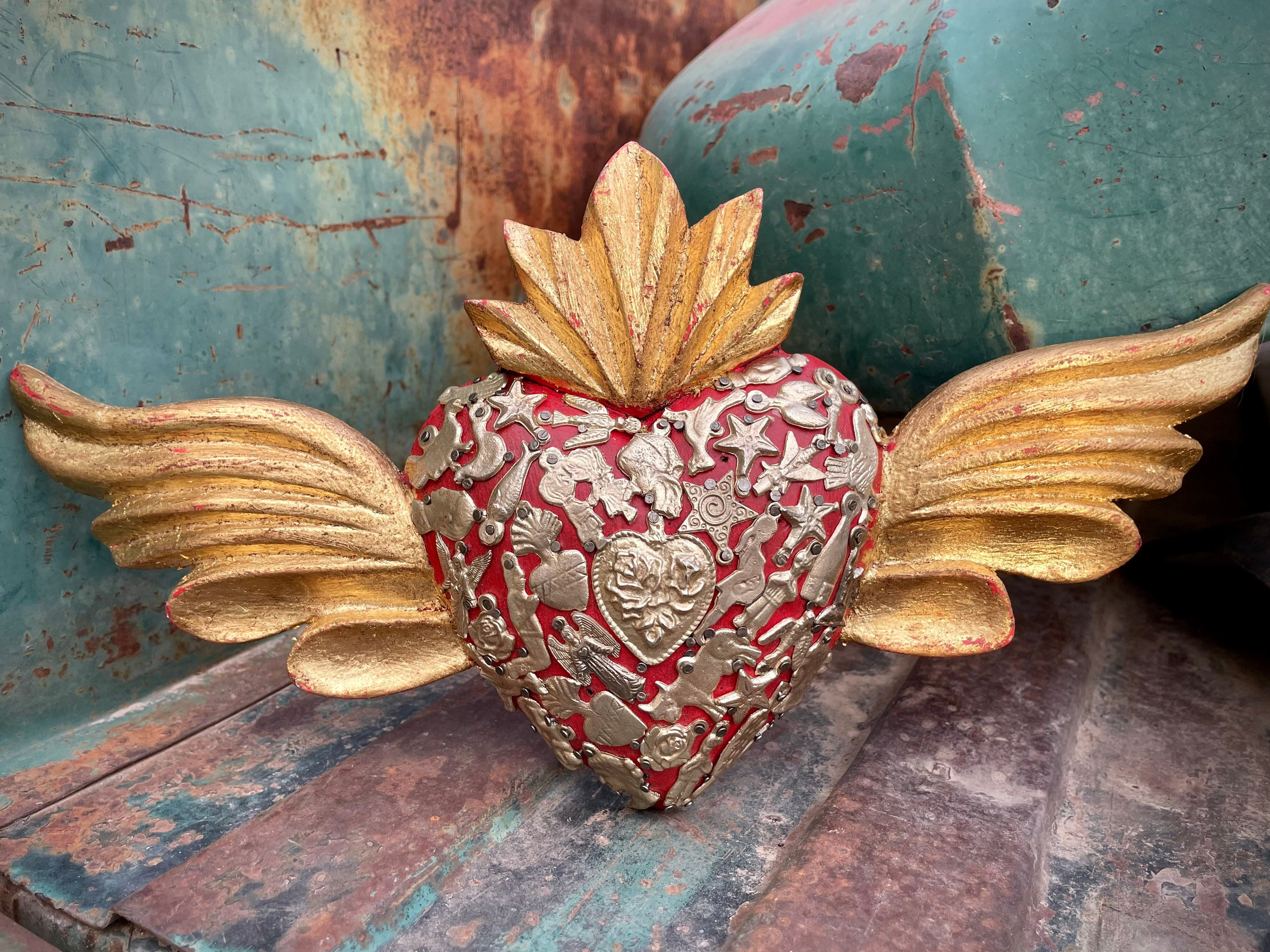 Mexican milagros colorful sacred heart former Mexican vote with wings