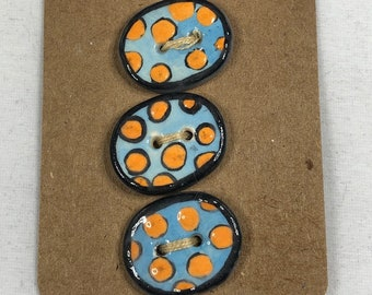 Orange Dots on Blue Buttons Small