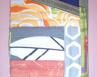 fone folios, quilted one-of-a kind pockets for your smart phone