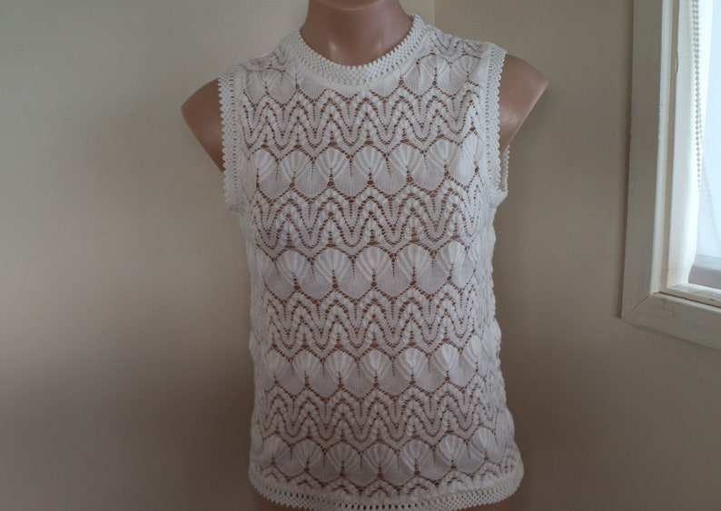 lacy white...ladies 1960s vintage knitted sleeveless blouse in white