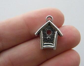 4 Bird house charms antique silver tone B159