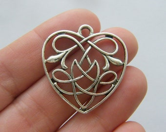 4 Celtic knot heart charms silver tone R130