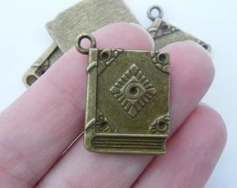4 Book charms antique bronze tone BC98