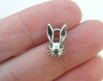 6 Rabbit charms antique silver tone A111