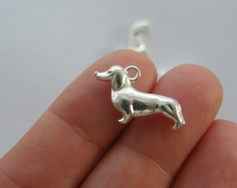 6 Dog charms antique silver tone A884