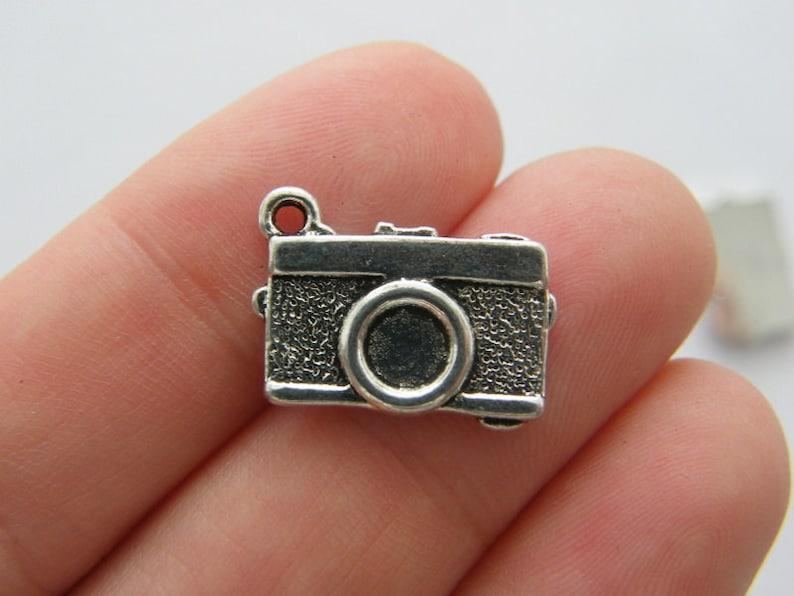 4 Cousin pendants antique silver tone M434