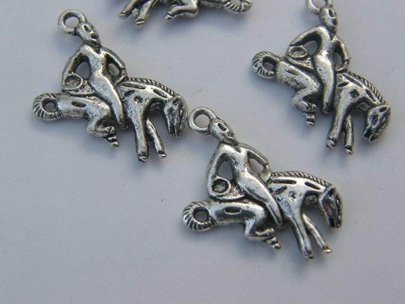 BULK 30 Rodeo charms antique silver tone A584