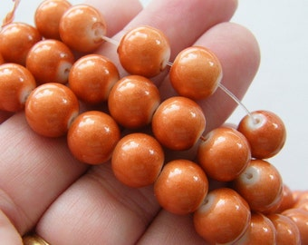 84 Burnt orange glitter glass 10mm beads B177