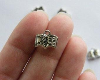 6 Book charms tibetan silver PT9