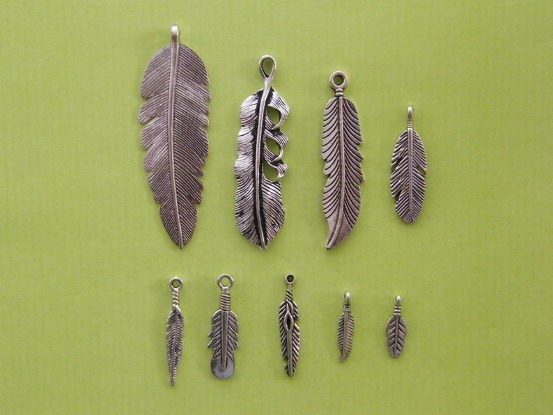 30de2308fce7b The Feather Collection - 9 antique silver tone charms